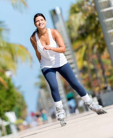 Sports woman skating outdoors keeping a healthy lifestyle Stock Photo - 19226741