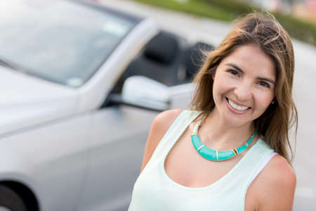 Happy woman going on a road trip in her car Stock Photo - 19226750