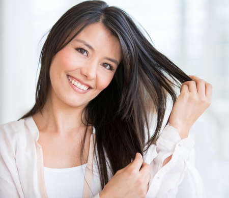Happy woman at the beauty salon in need of a haircut Stock Photo - 19249075