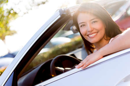 Happy woman driving a car and smiling Stock Photo - 19249074