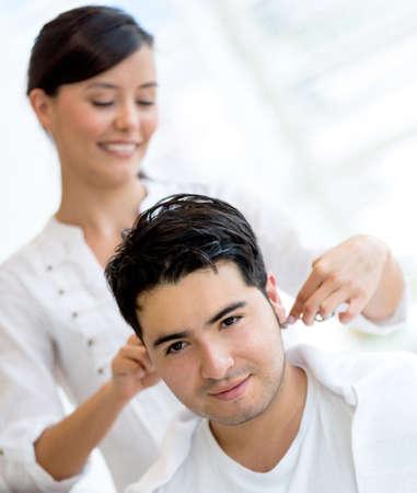 male hair: Man getting a haircut at the hair salon