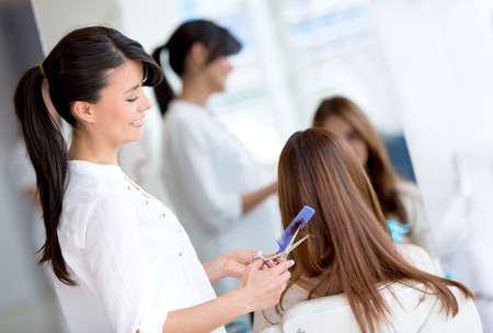 Woman at the hair salon getting a haircut photo