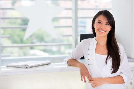 owners: Happy woman, business owner of a beauty salon Stock Photo