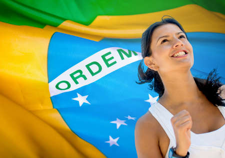 Happy woman running a marathon in Brazil photo