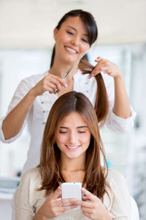 Girl getting a haircut at the beauty salon photo