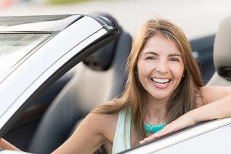 car driving: Woman driving a car looking very happy and smiling