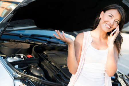 preoccupied: Woman with a broken car calling for help Stock Photo