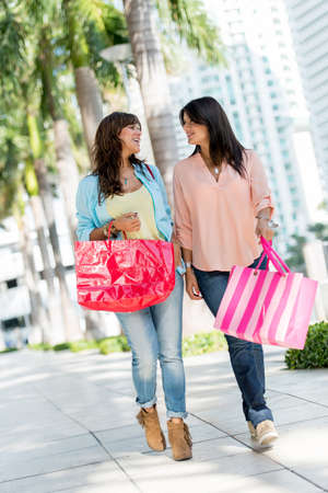 Happy shopping women walking in the streets of Miami with bags Stock Photo - 19400101