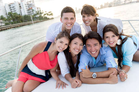 Group of people in a boat enjoying the summer photo