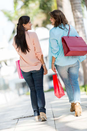 shopping spree: Female shoppers at the mall in Miami holding shopping bags