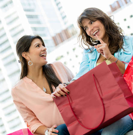 spree: Shopping women looking at purchases and smiling