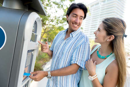 Couple paying for parking with a debit card Stock Photo - 19453892