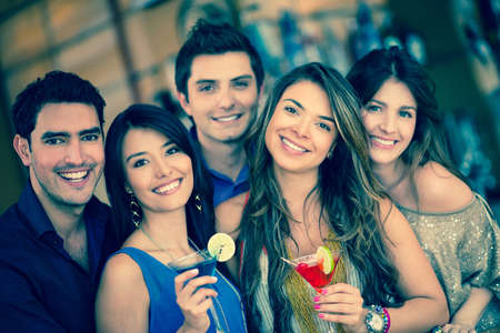going out: Group of friends going out to a bar and having drinks Stock Photo