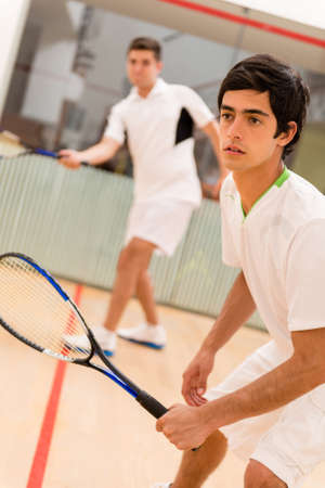 opponents: Male players playing a match of squash Stock Photo