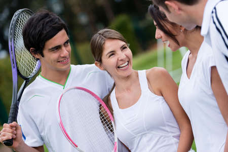 Group of friends at the club playing tennis photo
