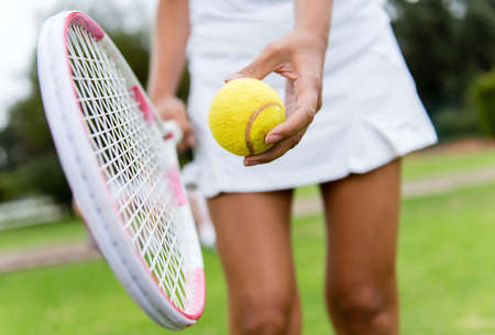 lawn tennis: Close up of a tennis player hitting the ball with racket