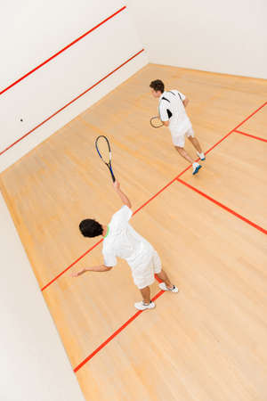 squash: Men at the court playing a match of squash