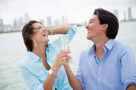 Romantic couple drinking champagne on a boat photo