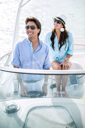 Romantic couple on a boat looking very happy photo