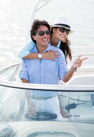 yacht people: Romantic couple on a yacht looking very happy Stock Photo