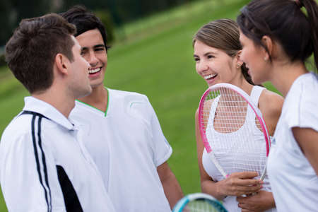Group of tennis players talking and looking happy Stock Photo - 19622348