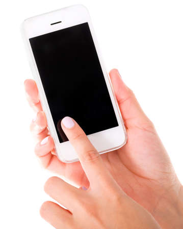 Using a touch screen cell phone - isolated over a white background photo