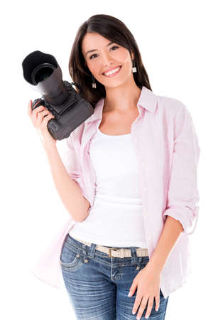 Happy female photographer holding camera - isolated over white photo