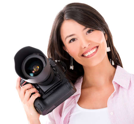 Woman holding a professional digital camera - isolated over white photo