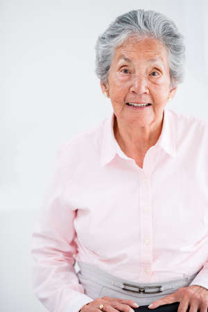 Portrait of an old woman smiling at home photo
