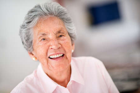 Portrait of a very happy senior woman - indoors photo