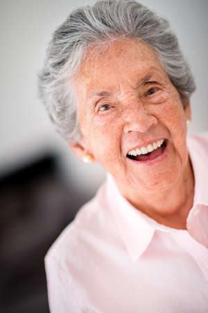 Portrait of a lovely old woman laughing photo