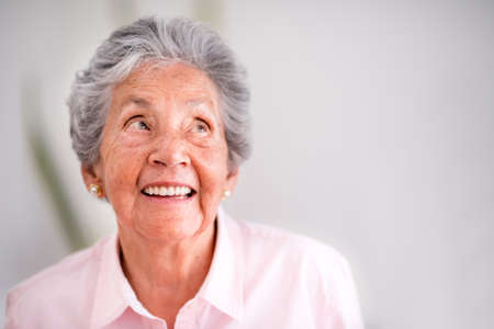 Portrait of a pensive senior woman smiling photo