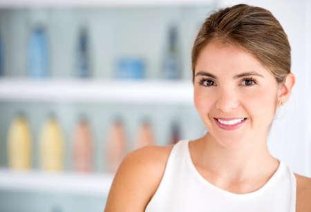Beautiful portrait of a stylist at the beauty salon photo