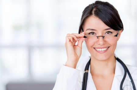 doctor of optometry: Portrait of a female doctor wearing glasses at the hospital Stock Photo
