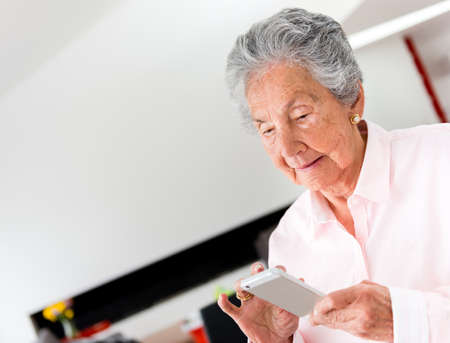 Senior woman using app on a smart phone Stock Photo - 19721220