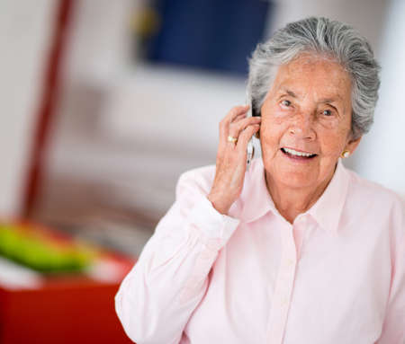 Elder woman talking on a mobile phone photo