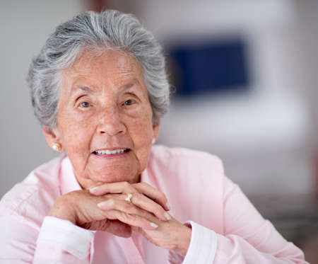Portrait of a beautiful elder woman smiling at home Stock Photo - 19721237
