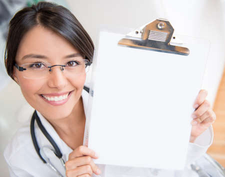 Happy female doctor holding at the hospital Stock Photo - 19721202