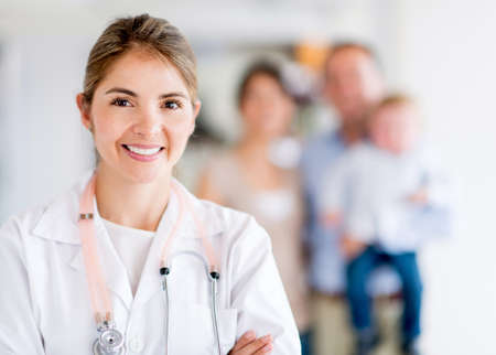 medical physician: Happy family doctor at the hospital looking happy Stock Photo