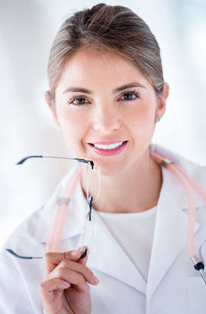 Portrait of a female doctor holding glasses Stock Photo - 19721163