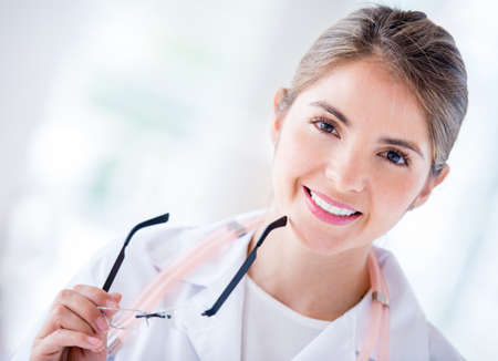 Portrait of a friendly female doctor at the hospital Stock Photo - 19721203