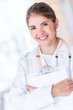 Female doctor holding a clipboard at the hospital Stock Photo - 19721233
