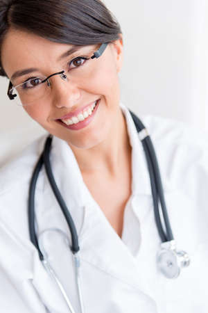 Portrait of a female doctor smiling at the hospital Stock Photo - 19721208