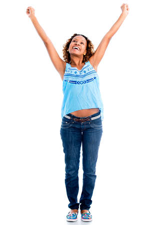 Excited woman with arms up - isolated over a white background photo