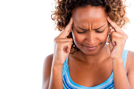 Frustrated woman having a headache - isolated over a white background photo
