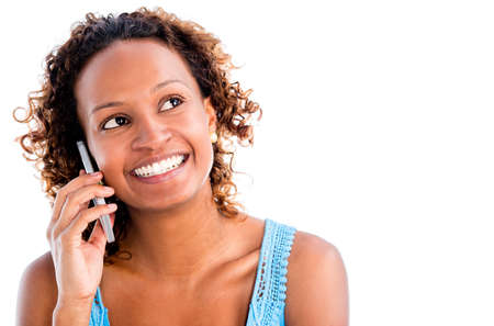 Woman talking on the phone - isolated over a white background photo