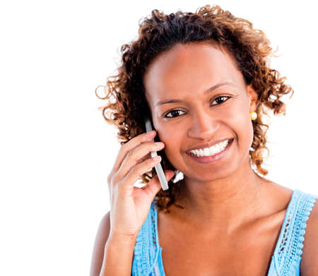 Woman making a phone call on her mobile - isolated over a white background photo