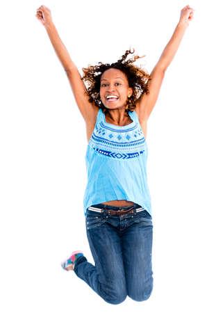 persona saltando: Saltando con los brazos encima de la mujer feliz - aislados en un fondo blanco Foto de archivo