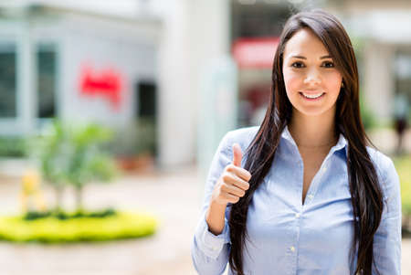 business like: Casual business woman with thumbs up looking happy