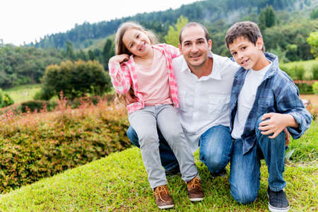 single person: Happy father enjoying with his kids outdoors and smiling Stock Photo